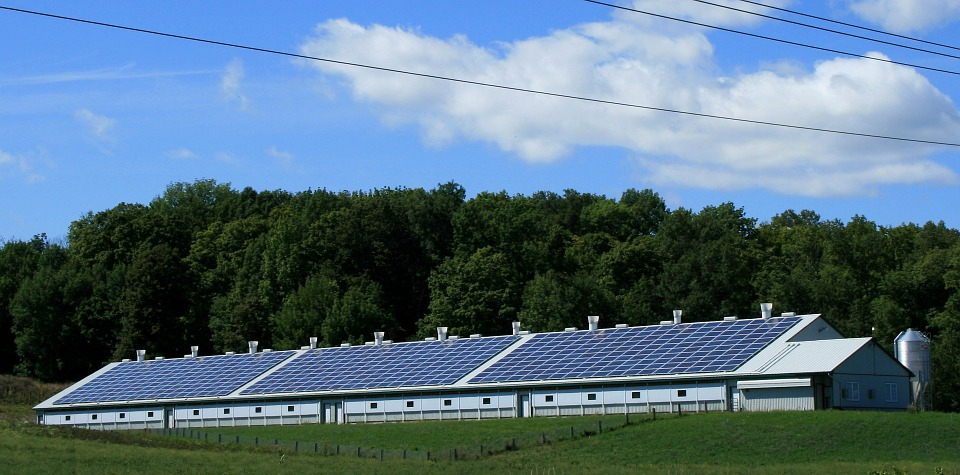 solar panel installation on a large barn roof